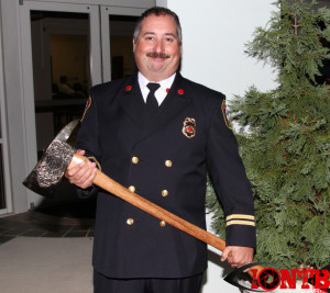 Chief Competelli holding his Golden Axe awarded this evening Belleair Bluffs City Hall