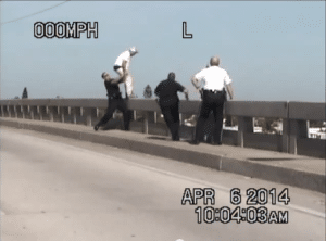 Deputies grab the 24 year-old suicidal subject from the railing of the Bay Pines Bridge