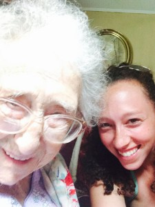 Helma learning about a selfie from her great granddaughter Sara.