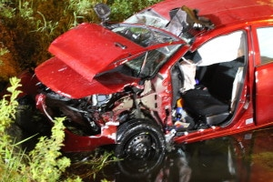 Vehicle sits at the bottom of ditch following rescue