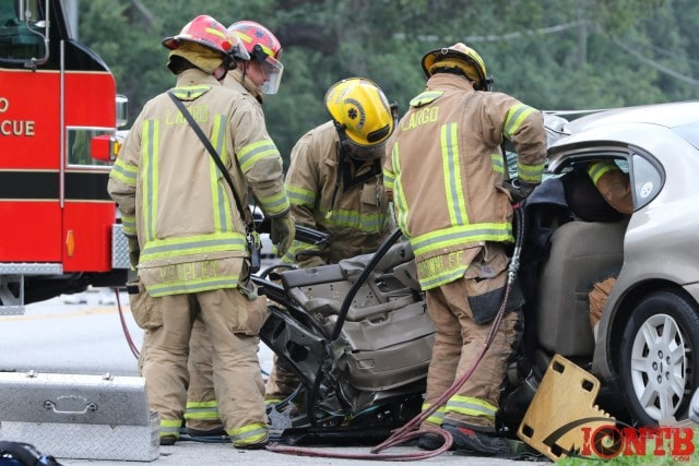 Crews working to extricate driver following crash on Keene Rd north of McMullen Rd