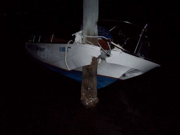Arnold's vessel stuck to marker after impact. Photo T. Enos (FWC)