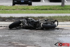 Burnt motorcycle on Park Street after fire extinguished