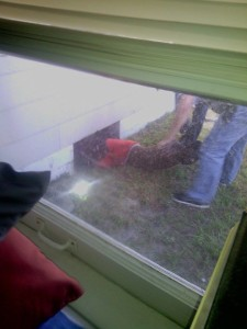 Mr. Burge being removed from under the home by Officers from St. Petersburg Police (Photo: Candi LIttle)